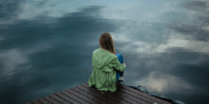 Person looking towards a lake view
